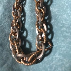 Silver and gold tone chain link necklace.